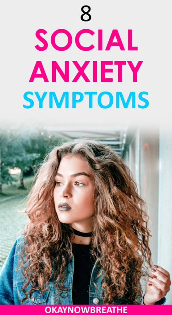 Female grabbing at strand of curly hair looking at the distance. Text reads 8 social anxiety symptoms