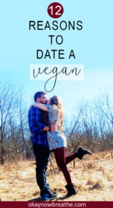 Couple hugging and kissing in a field. Female's leg is popped up to the back. Text says 12 Reasons to Date a Vegan