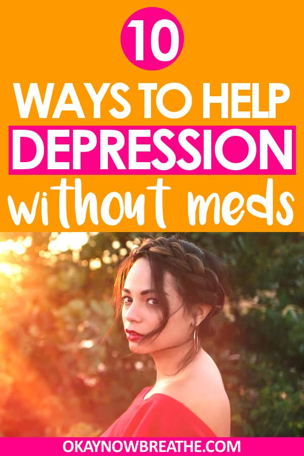 A female with her brunette hair in a bun wearing a red top. The sunshine is shining towards here. Text says 10 ways to help depression without meds