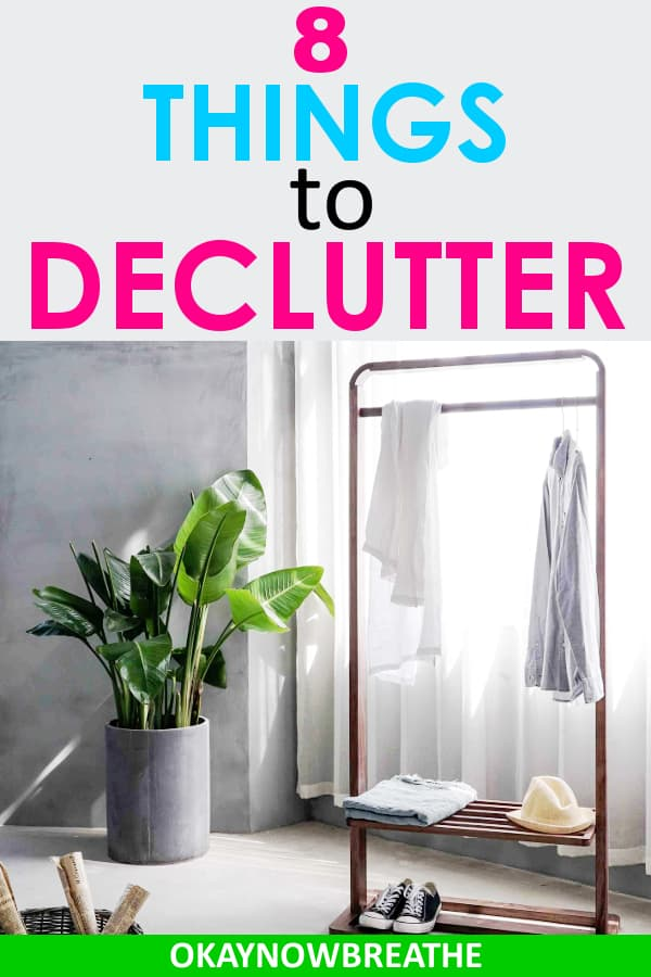 A clothing rack with two pieces on it next to a green plotted plant. The text says 8 things to declutter.