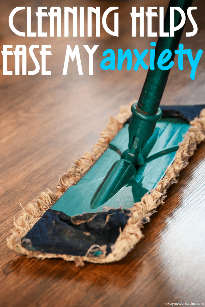 Mop on wooden floor with the words Cleaning Helps Ease My Anxiety