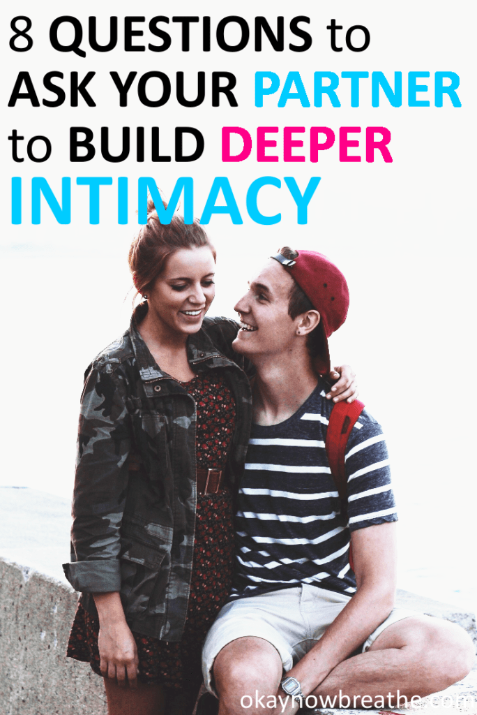 Couple both smiling. Text says 8 questions to ask your partner to build deeper intimacy