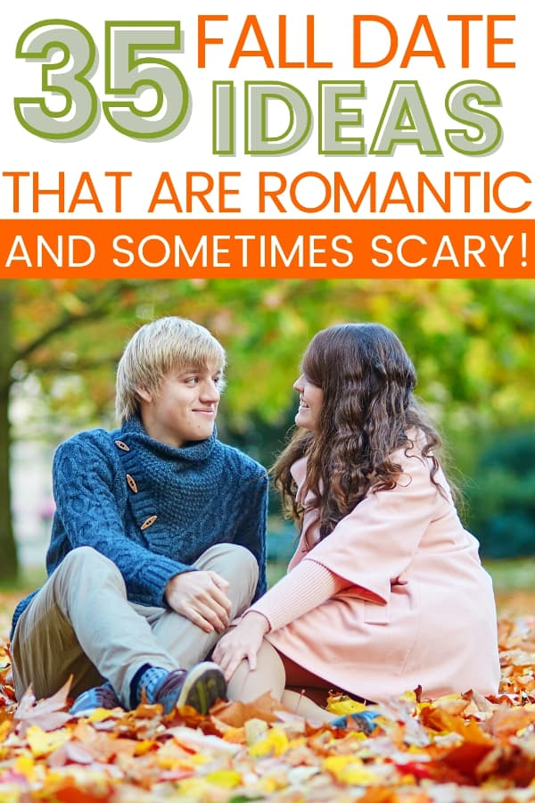 Young couple sitting on fall leaves on the ground. Title text says 35 fall date ideas that are romantic and sometimes scary!