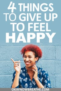 Female with red afro smiling and pointing. Text overlay says 4 things to give up to feel happy