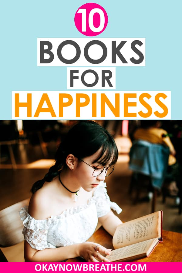 Female with glasses, black hair and bangs, a black choker necklace, and a white shirt reading a book. Title text reads 10 books for happiness