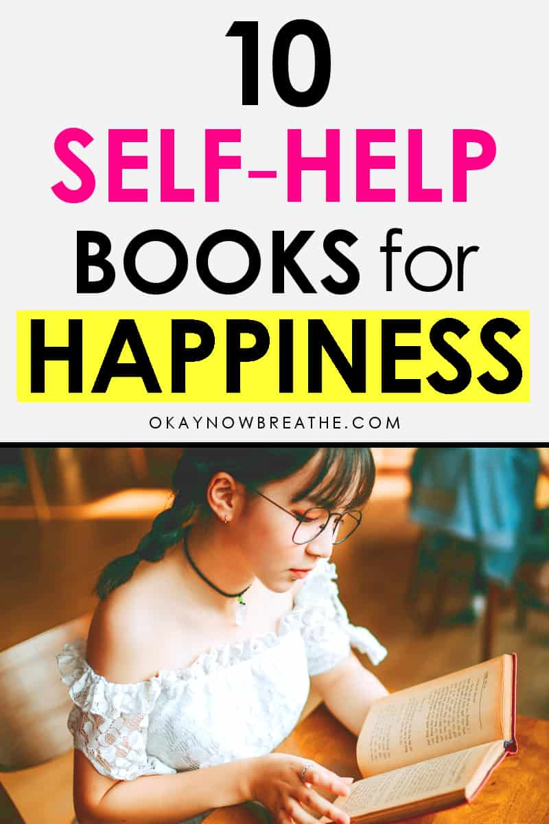 Female reading a book at a table. Text overlay says 7 self-help books for happiness