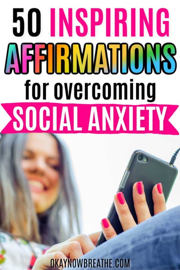Female looking at her phone and smiling. Text says 50 Inspiring Affirmations for Overcoming Social Anxiety