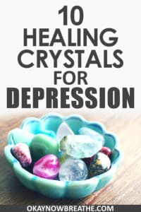 A variety of crystals and rocks in a blue green bowl with the text 10 Healing Crystals for Depression