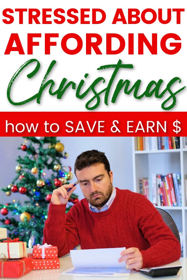 Man in red sweater next to Christmas tree and presents. He's holding piece of paper. Title says stressed about affording christmas. how to save and earn money