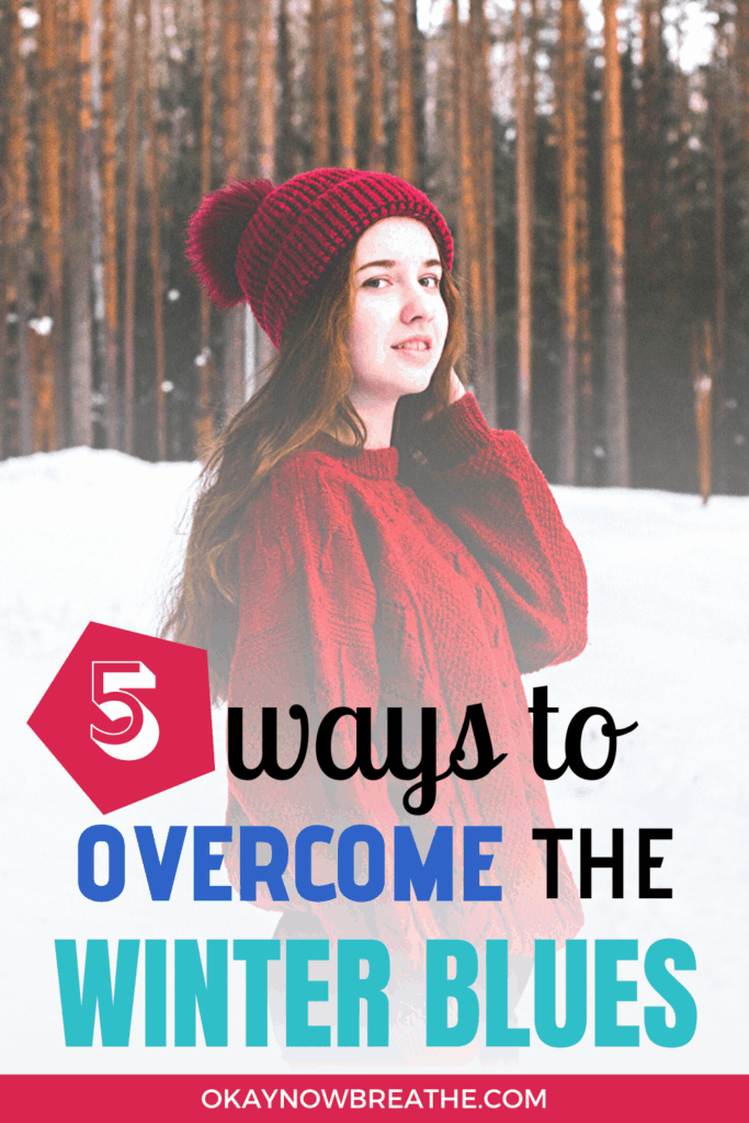 Female in a red sweater and winter hat standing in the snow. Text overlay says 5 ways to overcome the winter blues.