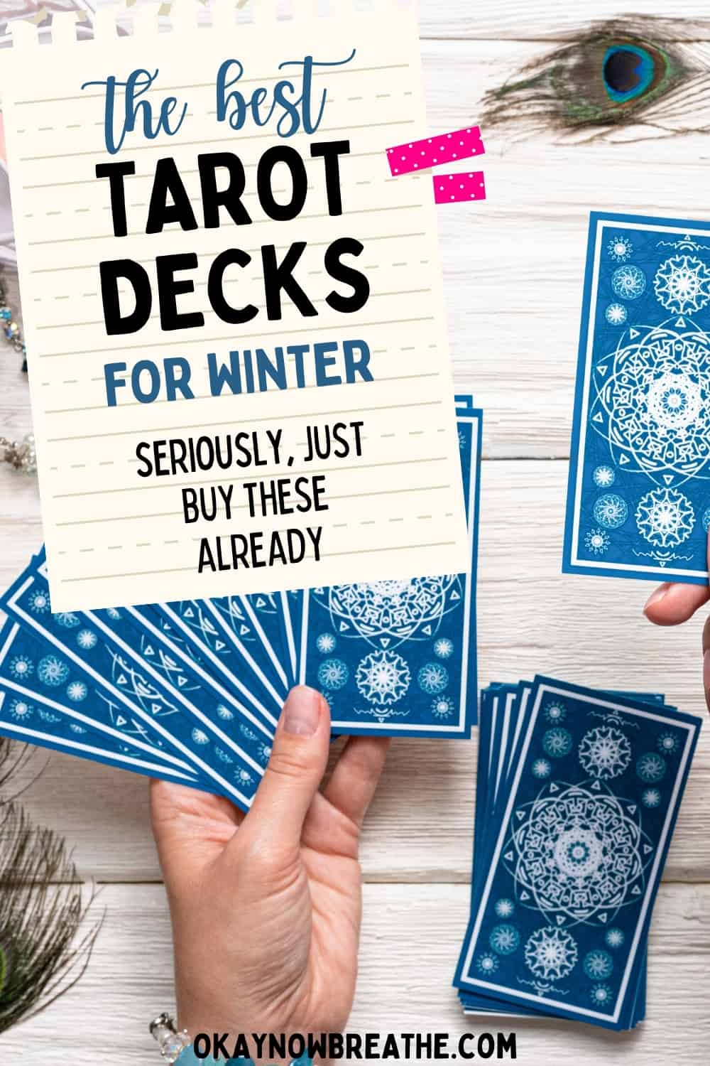 Blue tarot cards faced down. On image of paper, title says the best tarot decks for winter. seriously just buy them already