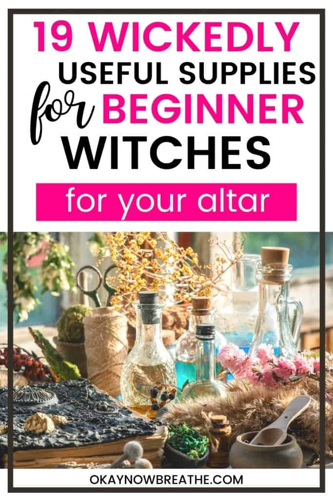 On a table there is a bunch of witch tools, such as dried herbs and flowers, glass bottles with spells and oils in them. Up top, the title says 19 wickedly useful supplies for beginner witches for your altar - okaynowbreate.com
